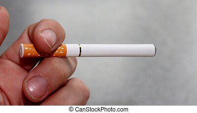 hand with electronic cigarette - electronic battery powered...