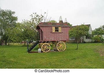 gypsy wooden caravan in a field - Gypsy caravan in field