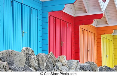 colourful paint wooden Victorian beach hut at the seaside