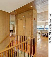 Closet separates staircase from living area - Light brown...