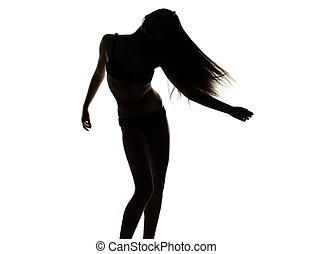 Silhouette of young dancing girl
