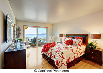 Romantic master bedroom interior with walkout deck. Bed with...