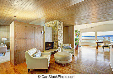 Beautiful house interior with wooden plank trim. Cozy...