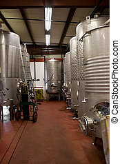 Wine Storage Tanks - Modern aluminum storage tanks where...