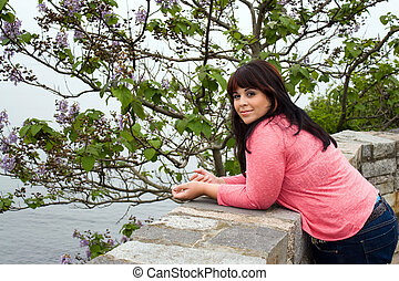 Woman Posing by the Sea - An attractive woman leans up...