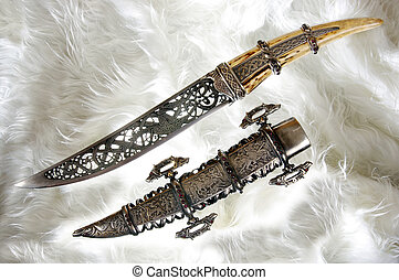 Smart dagger of the medieval soldier. It was used for...