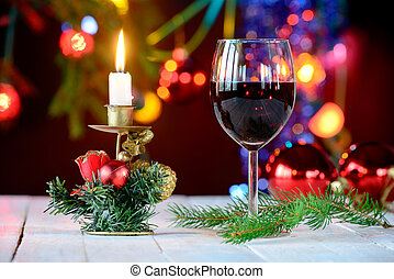 glass of red wine with Christmas decoration