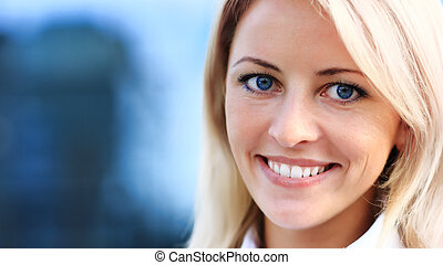 Close up portrait of young woman in business suit