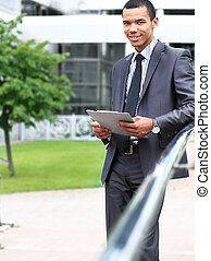 peaceful african american businessman outdoor