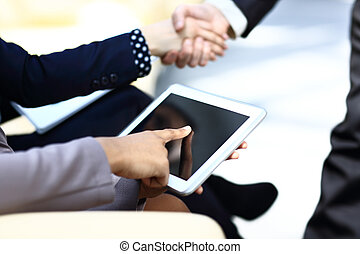 close up hands multitasking man using tablet, laptop and...