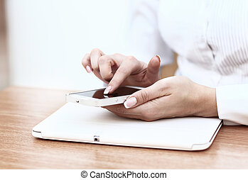 Young businesswoman working with modern devices, digital...