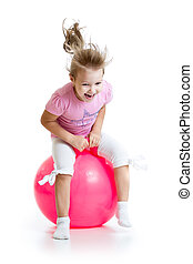 happy child jumping on bouncing ball Isolated on white