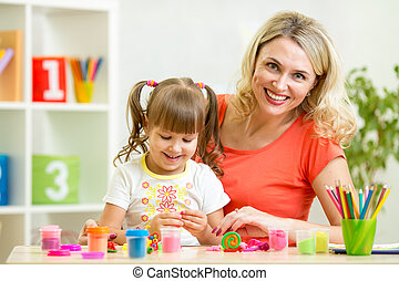 mom and daughter play colorful clay toy
