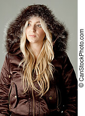 portrait of model wearing hood jacket