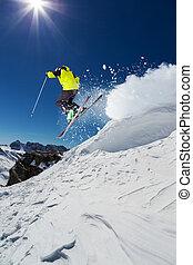 Alpine skier on piste, skiing downhill - Alpine skier skiing...