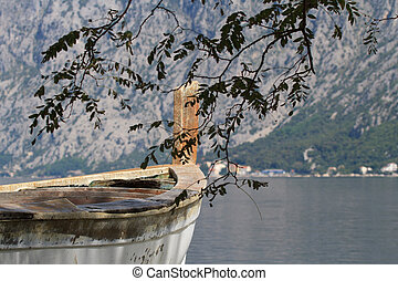 old boat closeup on a background of the bay and mountains. -...