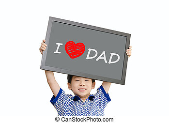"Little Asian boy holding chalkboard with message ""I love dad"""