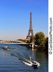 View on Eiffel Tower and boats on Seine river in Paris, France
