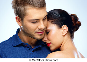 Portrait of a beautiful couple hugging