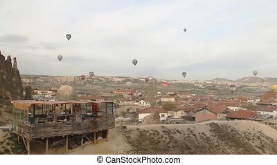 Hot Air Balloons and Rocks - Panoramic view taken from an...