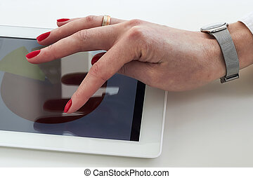 Businesswoman working with a tablet