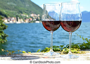 Two wineglasses Varenna town at the lake Como, Italy