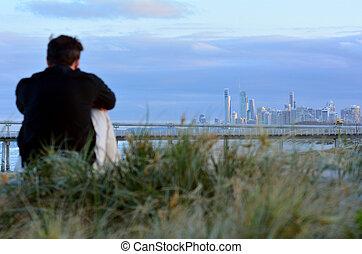 Man looks at Surfers Paradise skyline