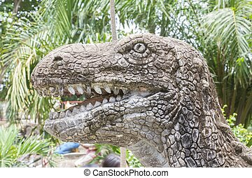 head of dinosaur sculpture in public park.