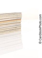 ?olorful magazines up close shot on white background
