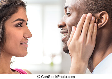 Portrait of beautiful couple looking at each other. closeup...