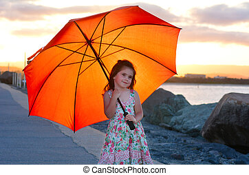 Little girl with umbrella - Little girl age 04 with red...