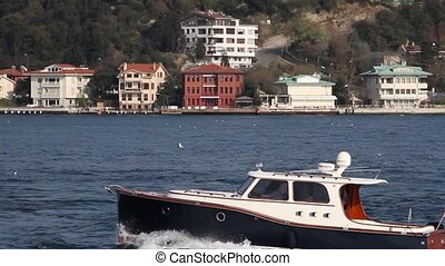 Boat on the Bosphorus with a Turkish Flag