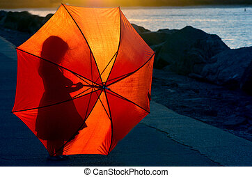 Silhouette of little girl with umbrella - Silhouette of a...