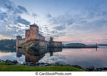 Olavinlinna fortress before sunrise. Early morning in...