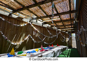 Sukkot Jewish Holiday - Interior of a Sukkah on Sukkot...
