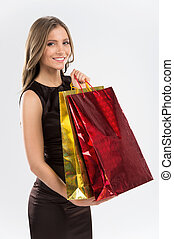Shopping woman holding bags isolated on white background...