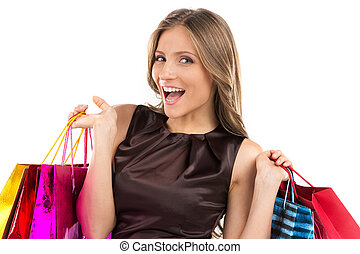 smiling woman holding bags isolated on white background...