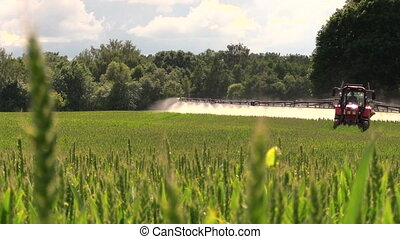 field spray - Tractor spray fertilize field with chemicals...