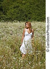 Woman Walking In Savage Garden - Woman In White Dress...