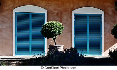 Blue shutters - Close up of Provence style house with blue...