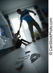 Domestic violence - Man beating the woman on the floor