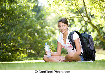 school girl - attractive girl learning in park