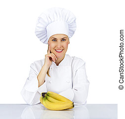 Woman chef in uniform. Isolated on white background with bananas
