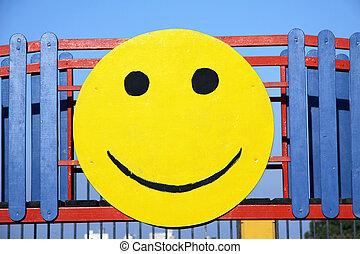 smiley face - a wooden circular image of a smiley face...