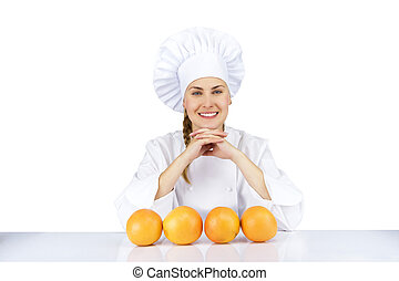 Woman chef in uniform. Isolated on white background with oranges