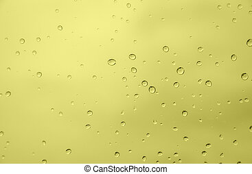 Drop water - abstract yellow color background with drop...