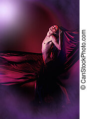 elegant dancerman - Art photo of a beautiful graceful brunet...
