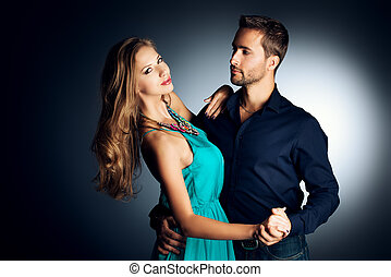 charming dance - Portrait of a beautiful young couple in...