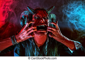 aggressive devil - Portrait of a devil with horns. Fantasy....