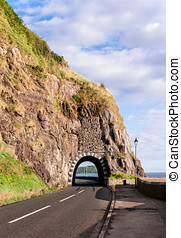 Coast road with tunnel, Northern Ireland - Coastal road with...